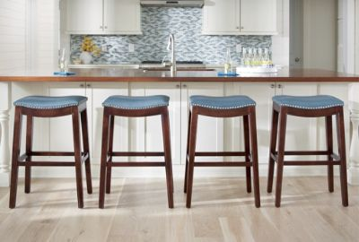 Pop dark framed counter or bar stools are stunning in a white space