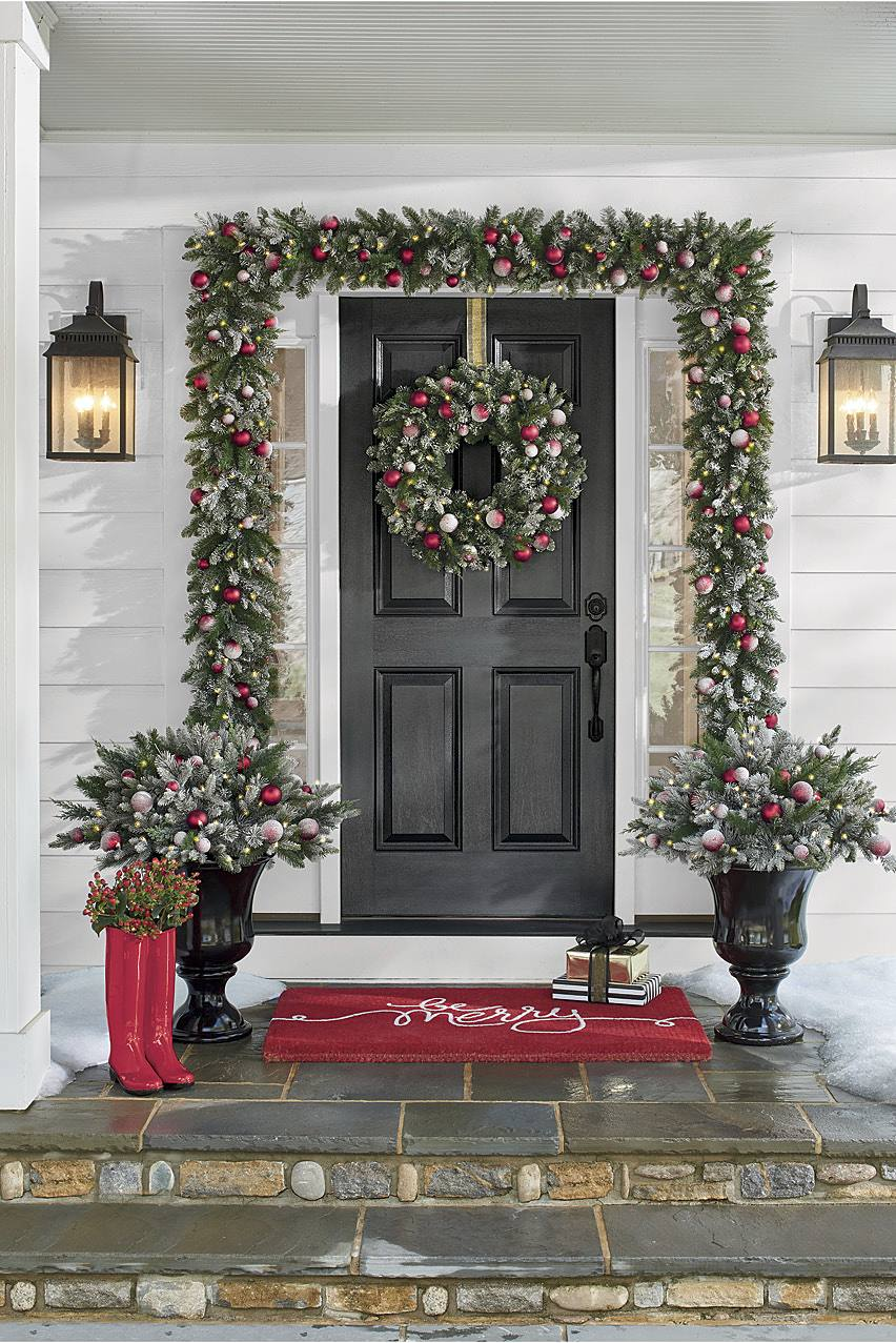 "Greenery pops with cheerful red accents, like our ""Be Merry"" Door Mat and Red Rain Boots"