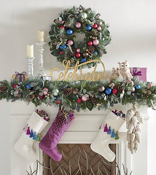 christmas mantle decorations in a sugar plum theme